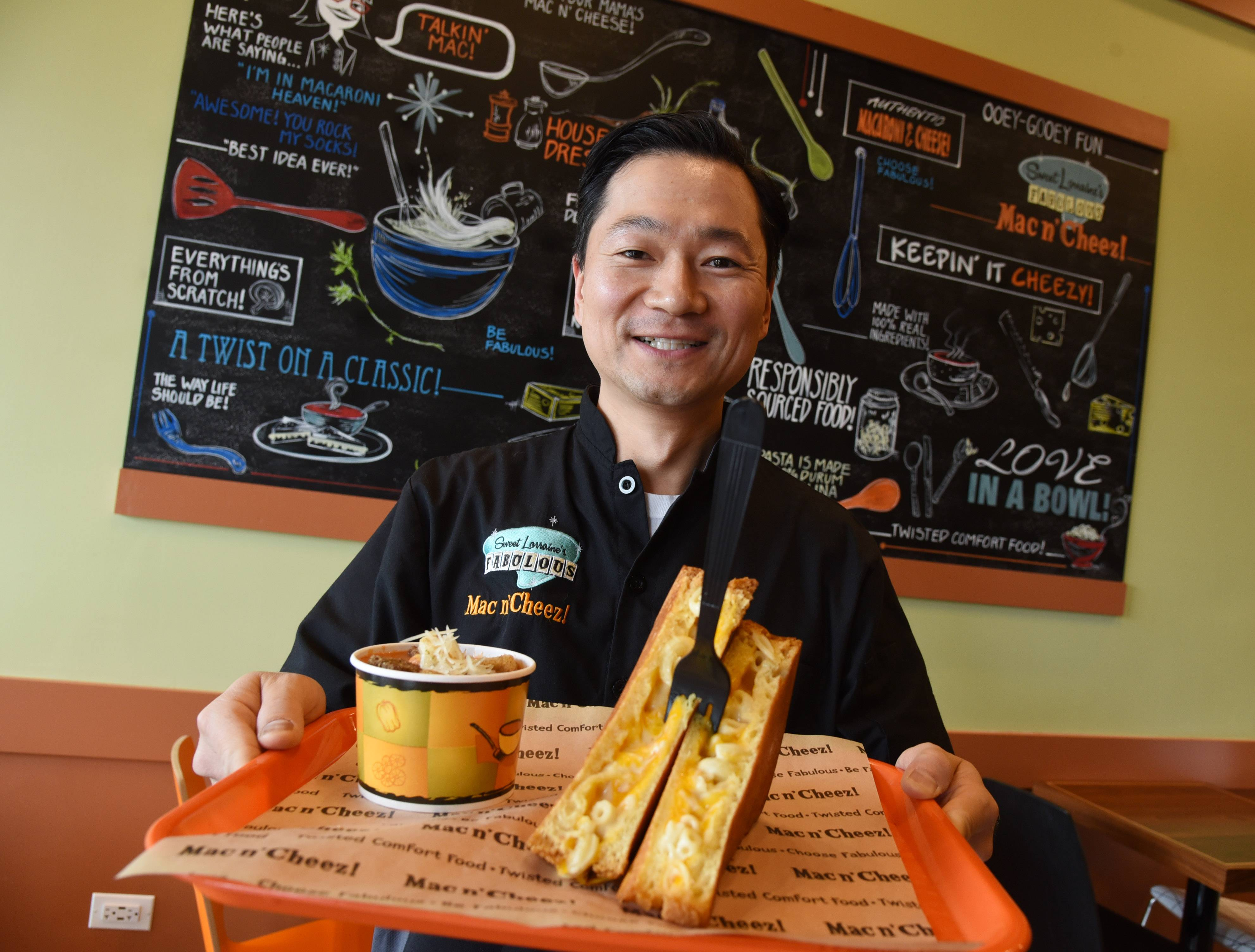 Sweet Lorraine's Fabulous Mac n' Cheez! owner Jeff Huh shows off a comfort food classic: cream of tomato soup and the Twisted Classic grilled cheese sandwich.