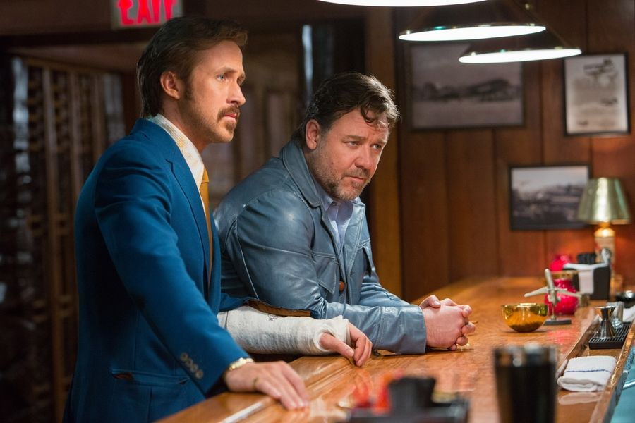 "Inept detective Holland March (Ryan Gosling), left, and thug-for-hire Jackson Healy (Russell Crowe) team up in ""The Nice Guys."""