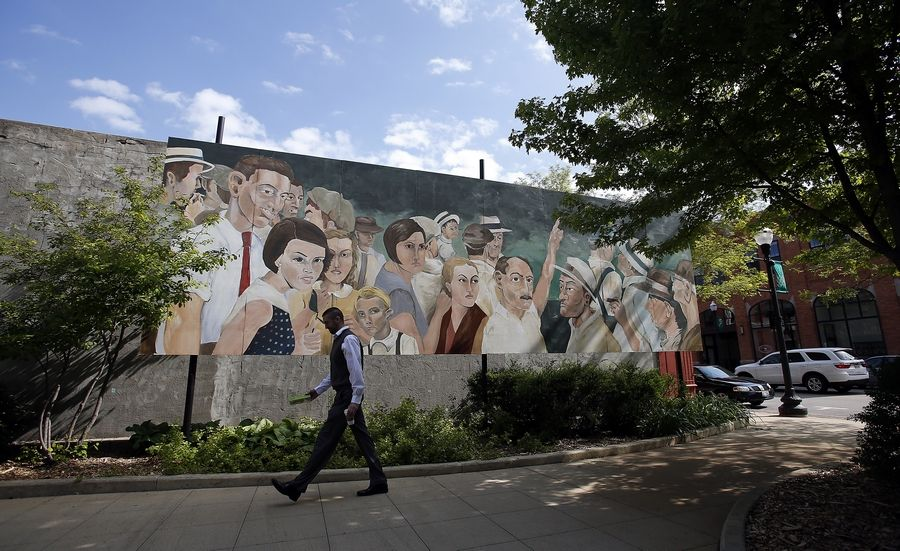 This mural in downtown Elgin mimics a 1930 photo of a crowd that gawked at the lynching of two black men in Indiana.