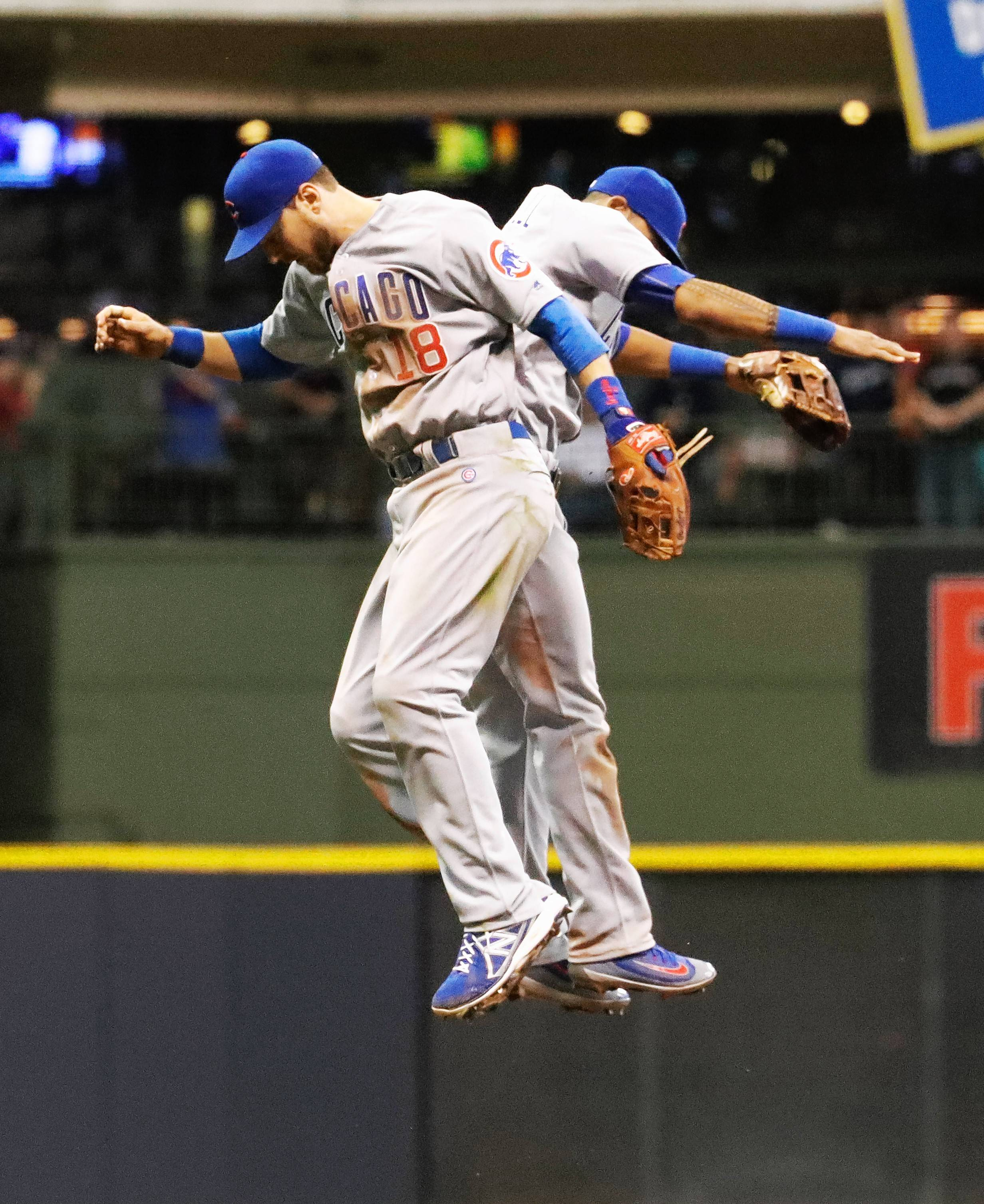 Chicago Cubs' Ben Zobrist (18) and Addison Russell celebrate after the 13th inning of a baseball game against the Milwaukee Brewers Thursday, May 19, 2016, in Milwaukee. The Cubs won 2-1. (AP Photo/Morry Gash)