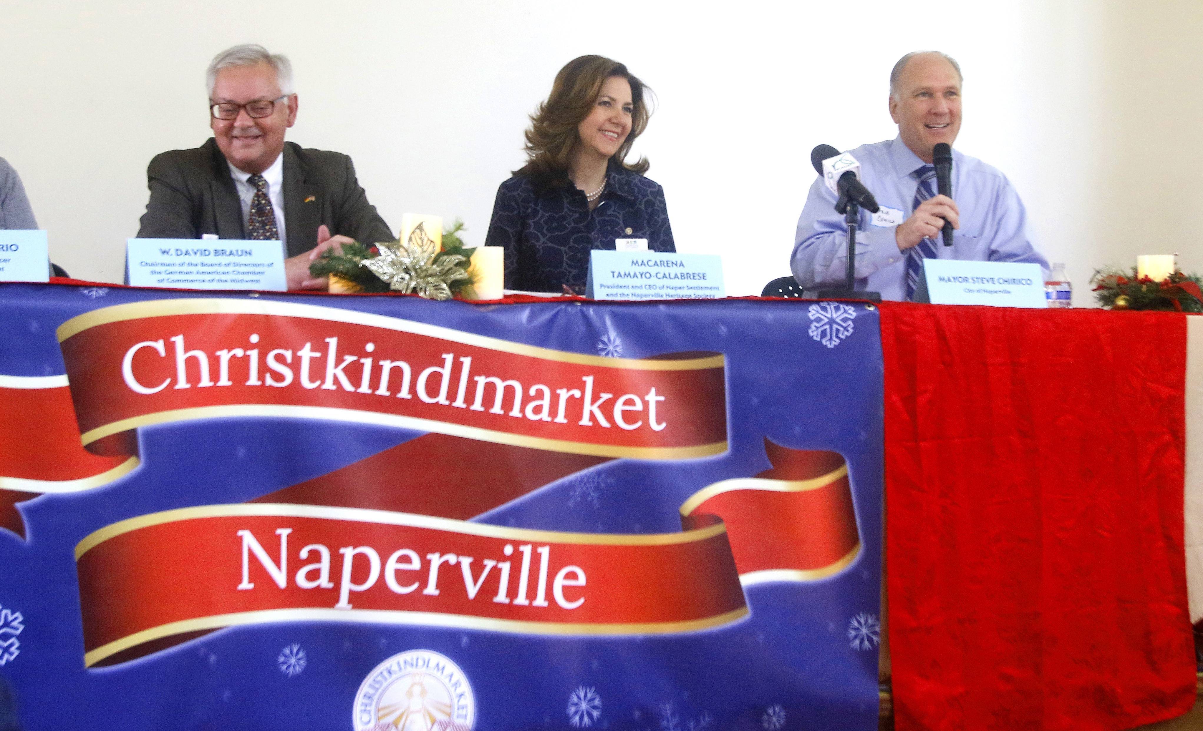 Naperville Mayor Steve Chirico, right, announces the opening of a Christkindlmarket suburban location beginning Nov. 25 at the Naper Settlement. Rena Tamayo-Calabrese, Naper Settlement president and CEO, and W. David Braun, chairman of the German American Chamber of Commerce of the Midwest, say the historical museum is the perfect venue for the festive market.