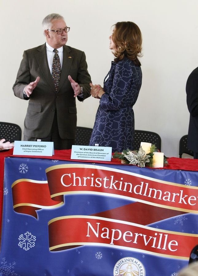 W. David Braun, chairman of the German American Chamber of Commerce of the Midwest, talks Thursday about the Christkindlmarket his organization is bringing to the Naper Settlement starting Nov. 25 with Naper Settlement President and CEO Rena Tamayo-Calabrese.