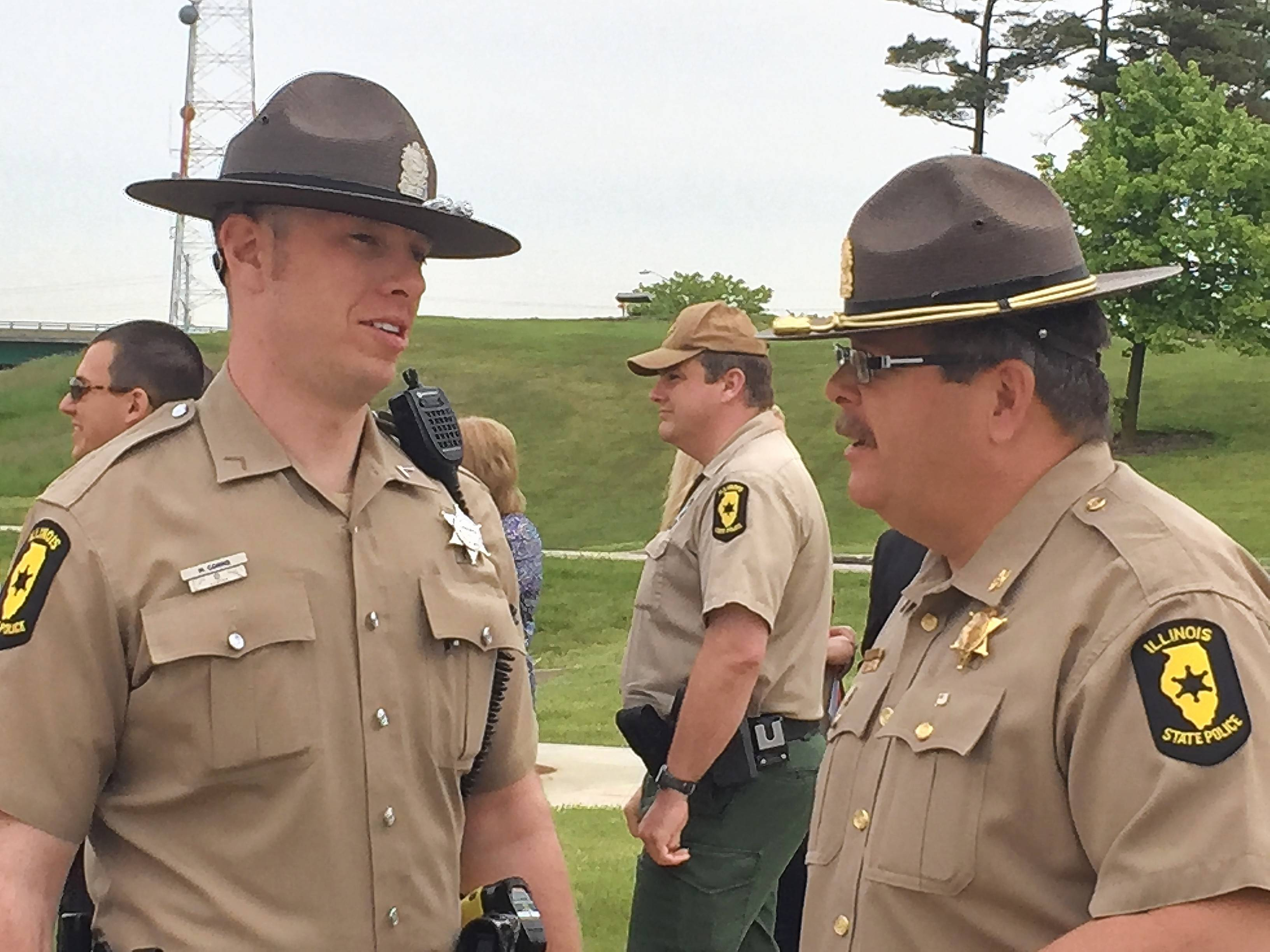 Illinois State Police Col. Tad Williams, right, welcomed Trooper Michael Cokins back to duty prior to a Friday ceremony in Downers Grove. Cokins was seriously injured 20 months ago when he was struck by a drunken driving suspect during a traffic stop.