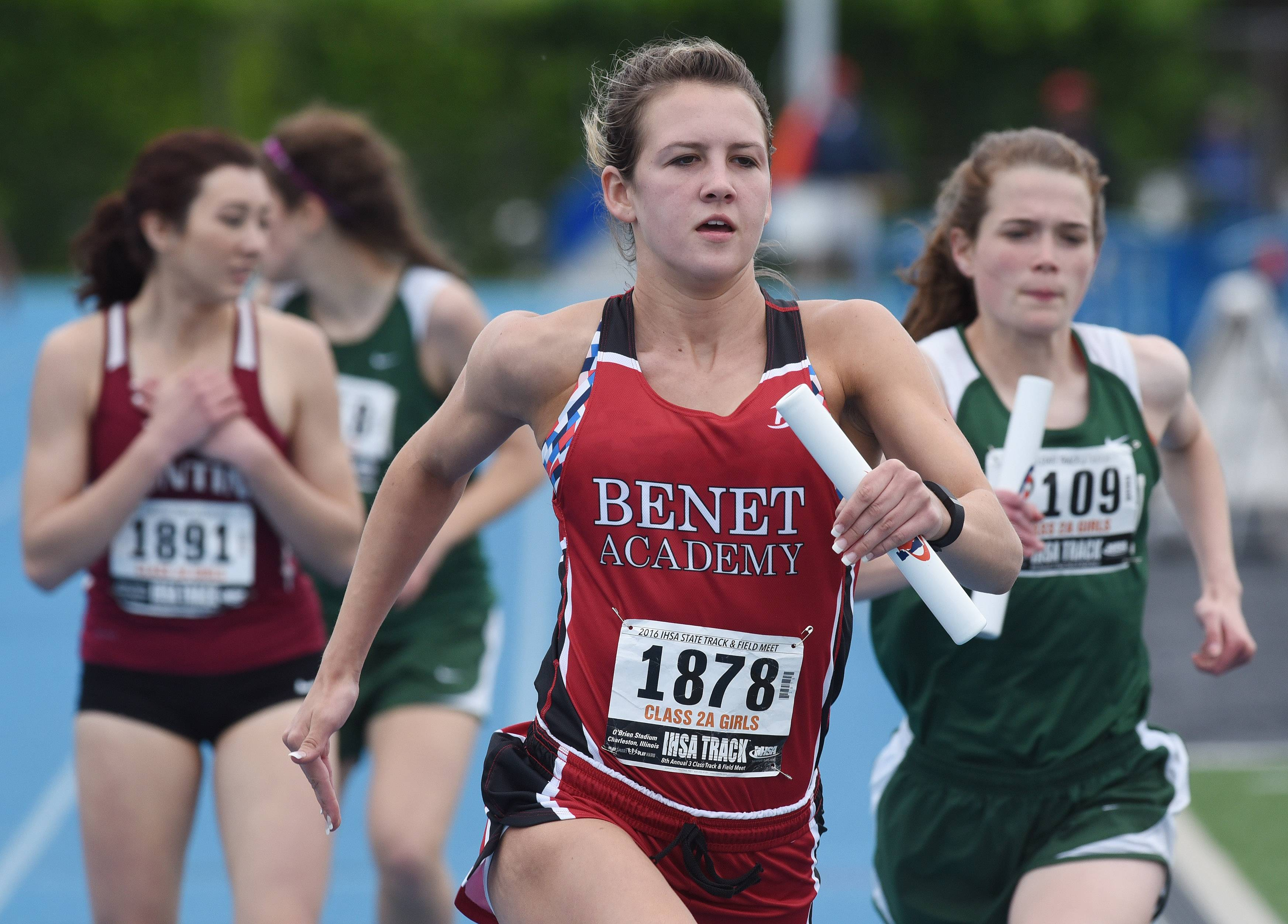 Benet's Kerry Steed carries the baton for her team in the 3200-meter relay.