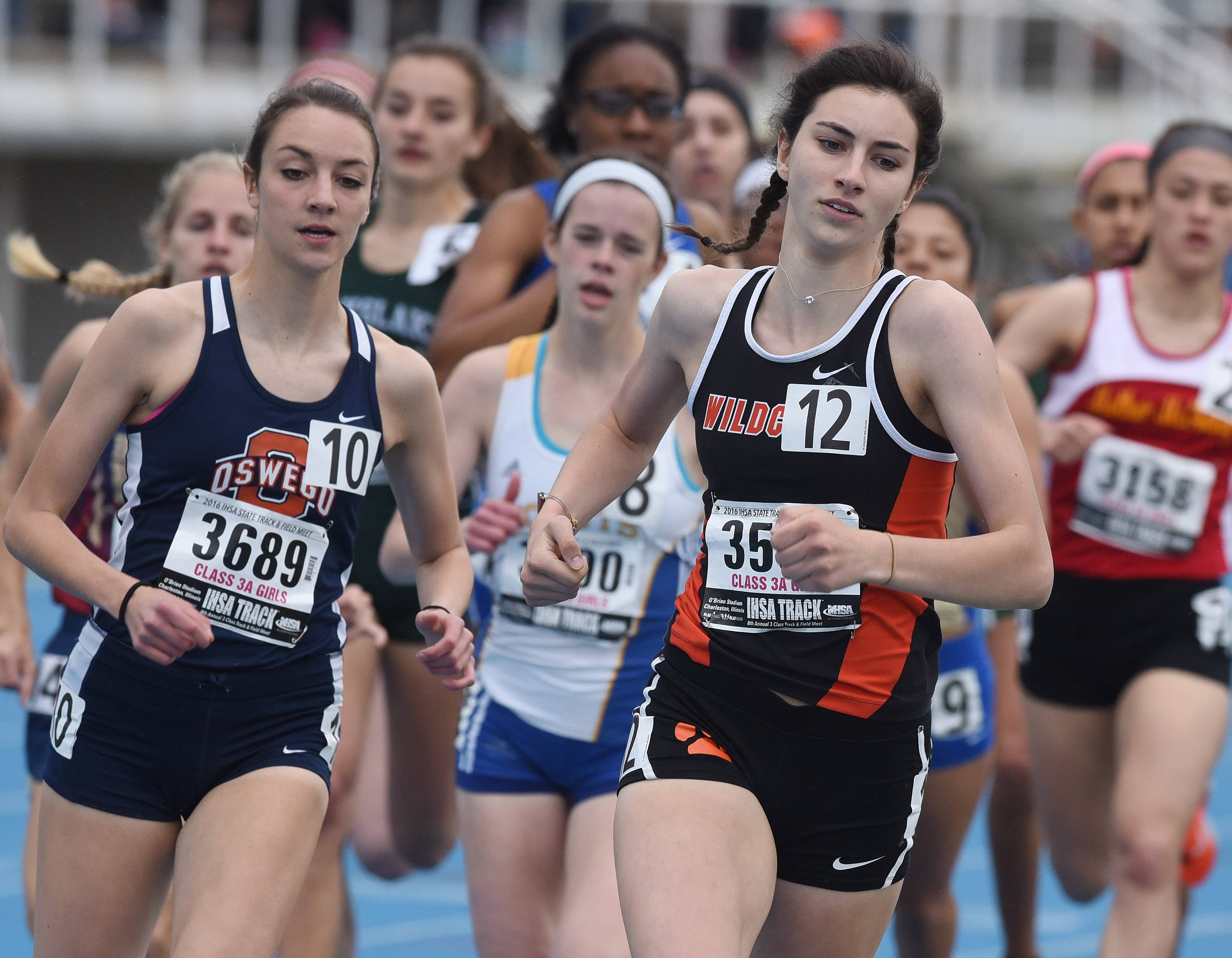 Libertyville's Avryl Johnson is out in front during heat one of the 800-meter run during the Class 3A girls state track meet preliminaries in Charleston on Friday.