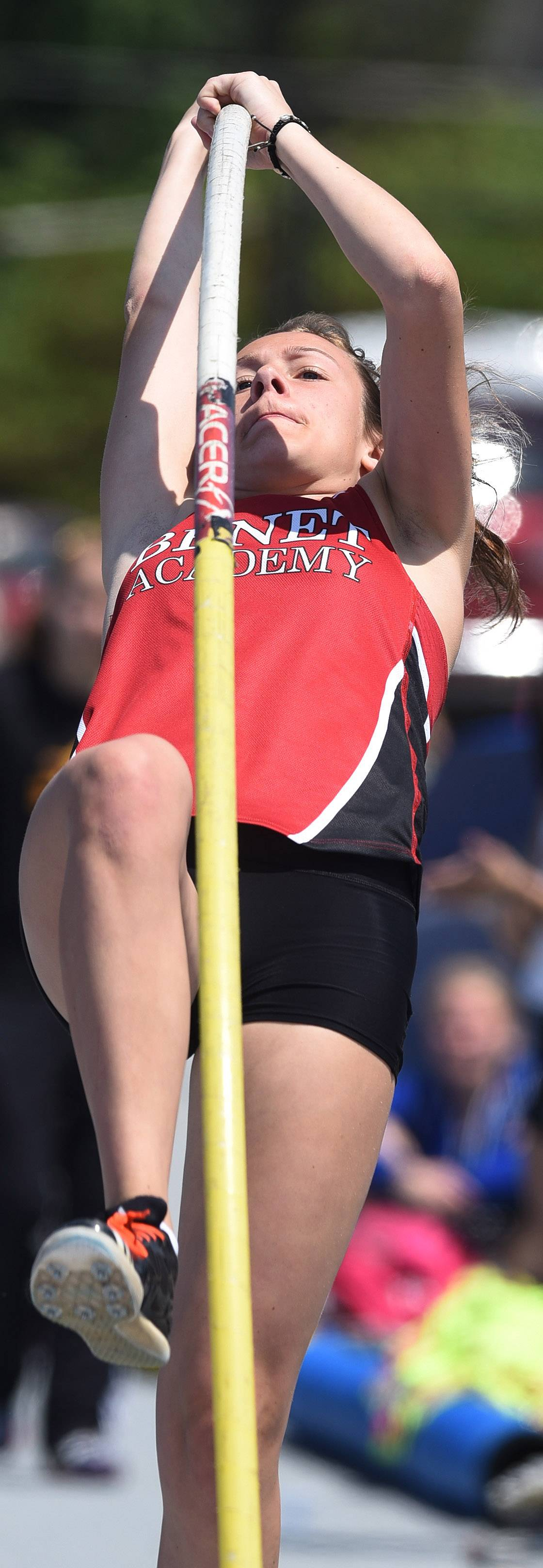Ali Munson of Benet Academy pole vaults toward a class 2A state title during the IHSA girls state track finals in Charleston Saturday