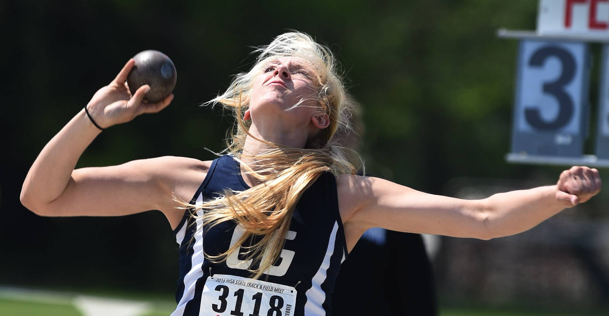 Cary Grove's Nikki Freeman throws in the Class 3A shot put during the IHSA girls state track finals in Charleston Saturday. Freeman finished fourth in the event and also won the state championship in the discus throw.