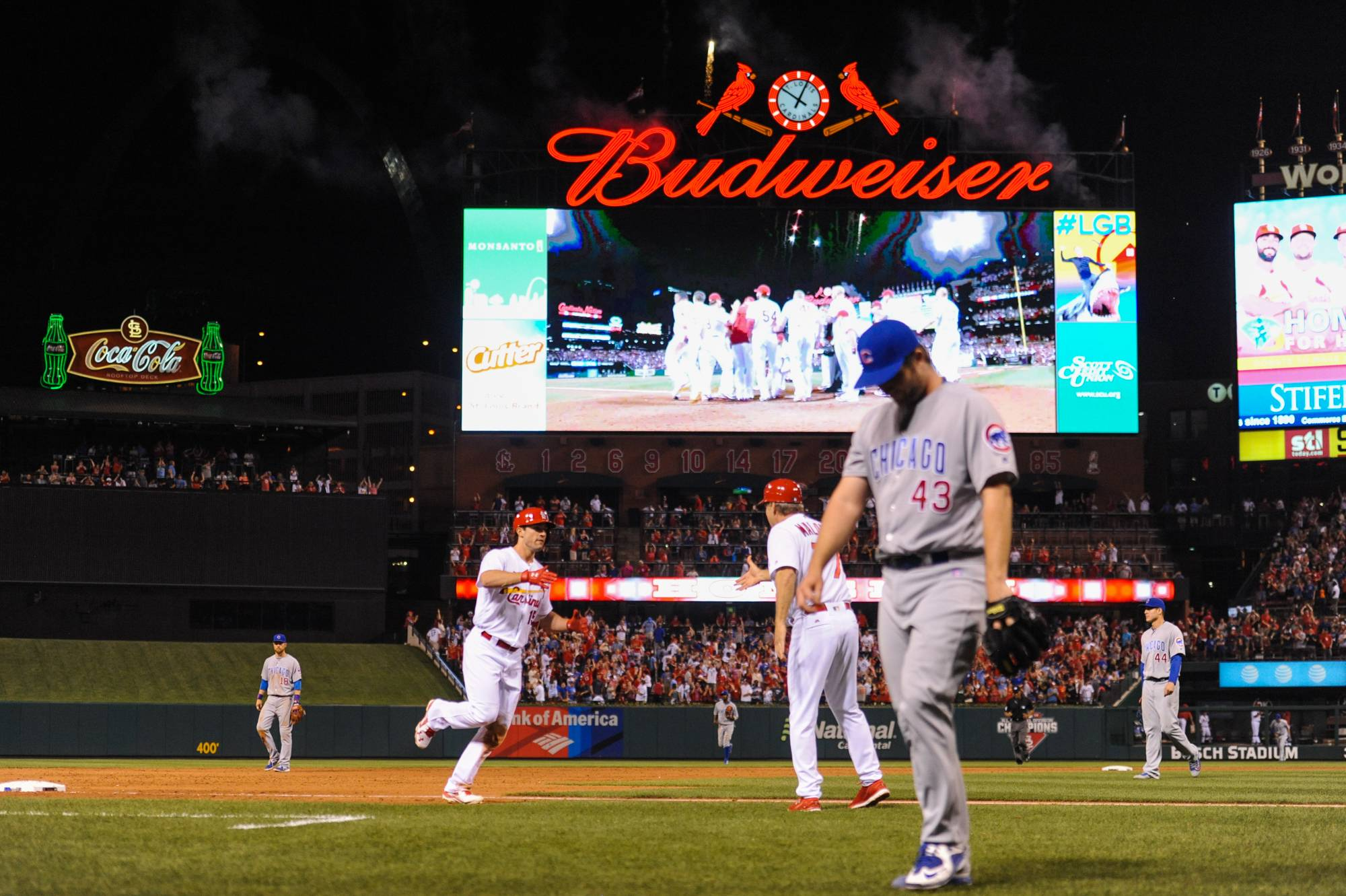 St. Louis Cardinals' Randal Grichuk (15) rounds the bases after hitting a walk-off home run in the ninth inning of a baseball game against the Chicago Cubs on Monday, May 23, 2016, in St. Louis. The Cardinals defeated the Cubs 4-3. (AP Photo/Michael Thomas)