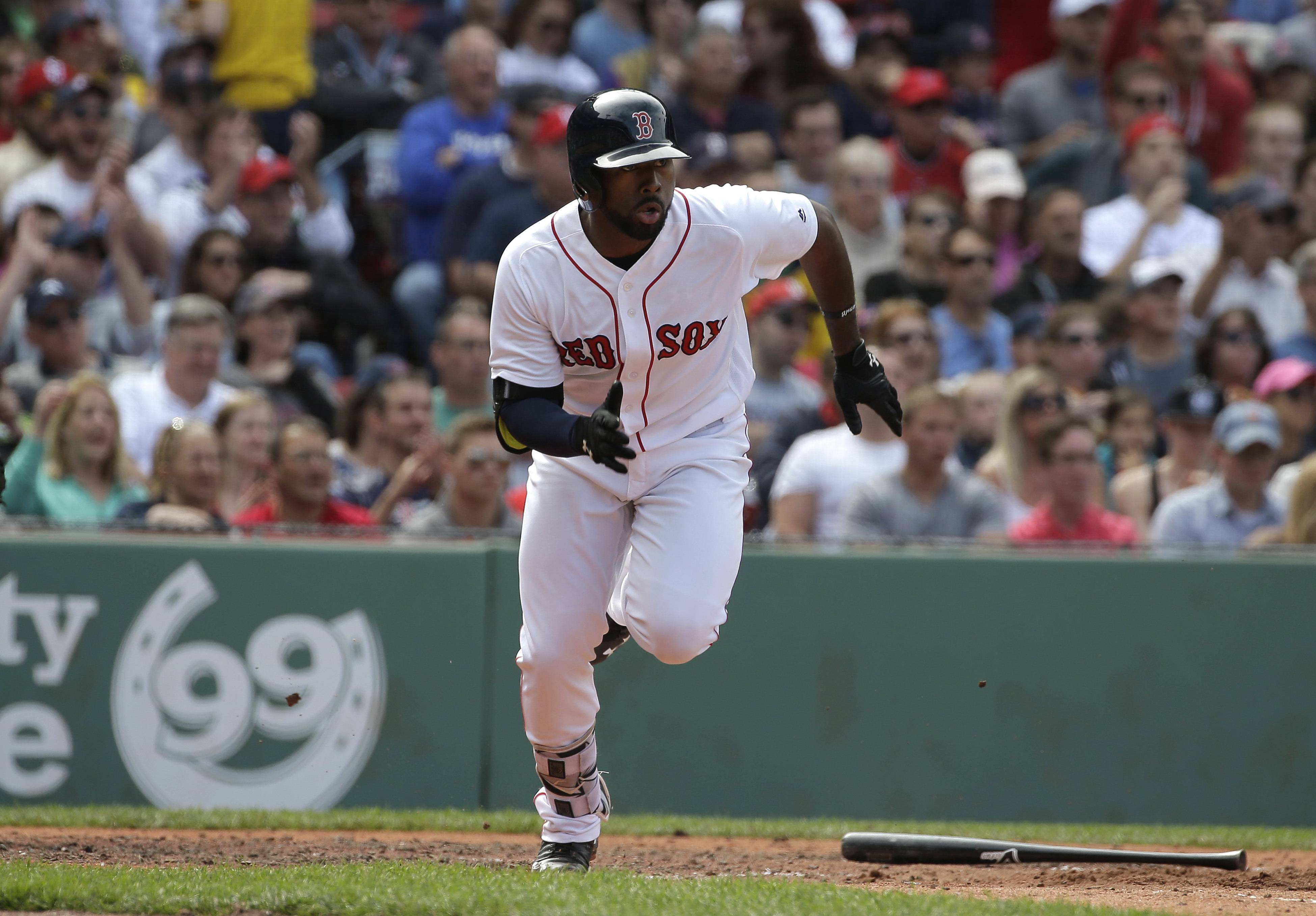 Boston Red Sox's Jackie Bradley Jr. runs toward first base as he singles off a pitch by Cleveland Indians' Danny Salazar in the fifth inning of a baseball game at Fenway Park, Sunday, May 22, 2016, in Boston. (AP Photo/Steven Senne)