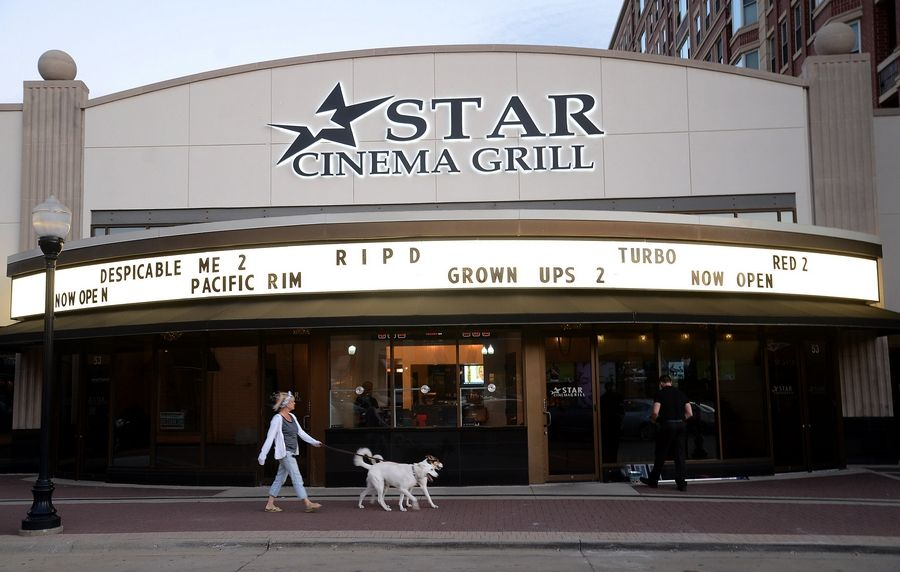 Arlington Town Square, which includes Star Cinema Grill, is up for sale.