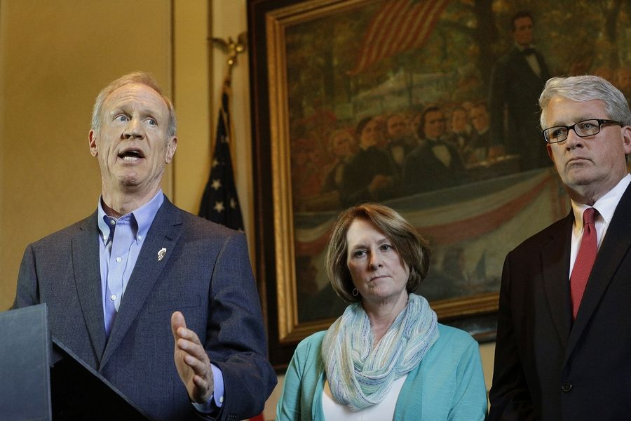 Illinois Gov. Bruce Rauner speaks to reporters in his office at the Illinois State Capitol Monday, May 23, 2016, in Springfield, Ill. Rauner and Republican leaders in the Illinois Legislature gathered to talk about the final week of the legislative session. Looking on is Illinois Senate Minority Leader Christine Radogno, R-Lemont, center, and Illinois House Minority Leader Jim Durkin, R-Western Springs, right.