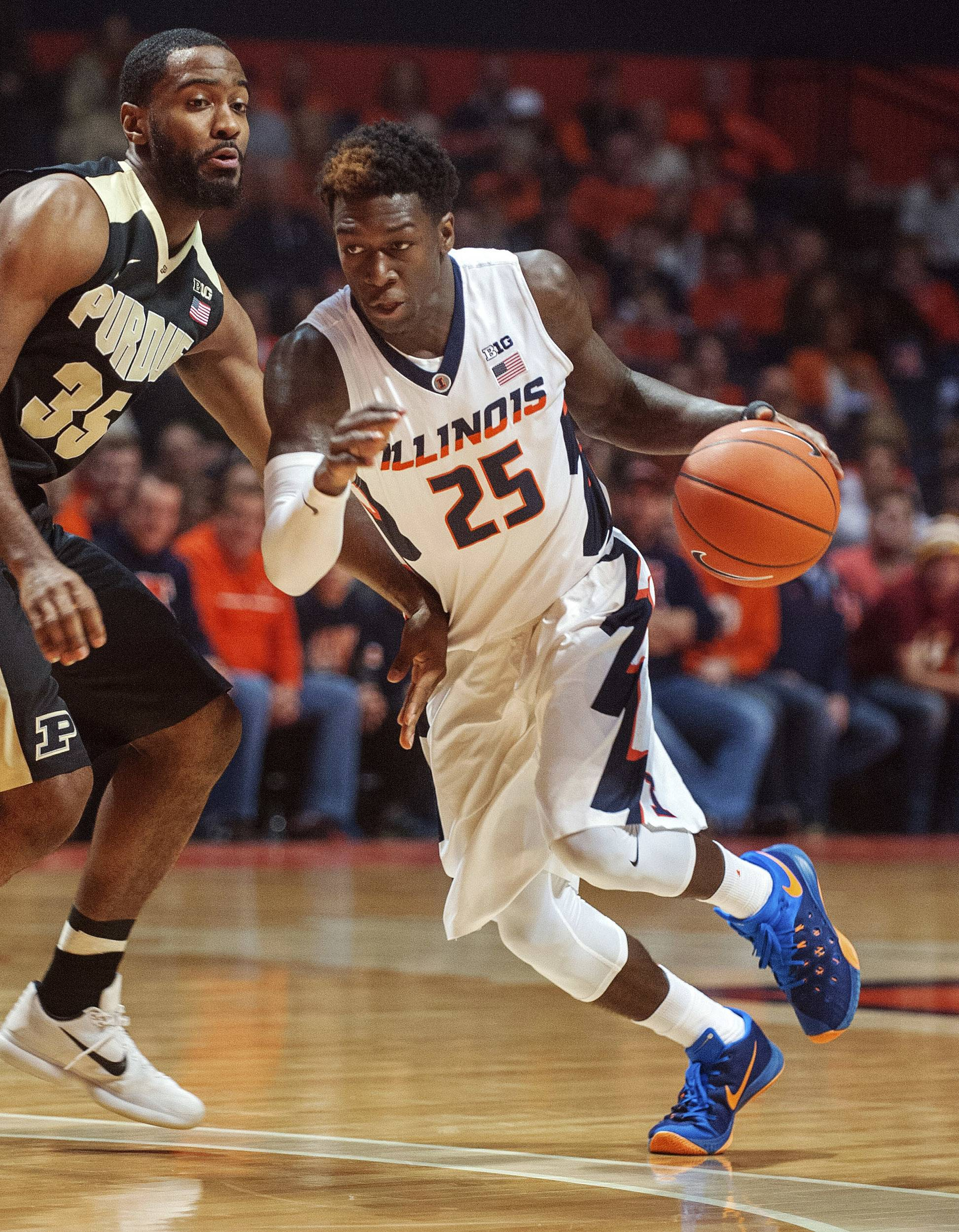 FILE — In this Jan. 10, 2016, file photo, Illinois' Kendrick Nunn (25) drives to the basket during an NCAA college basketball game against Purdue in Champaign, Ill. Nunn was dismissed from the basketball team on Tuesday, May 24, 2016, following his guilty plea to misdemeanor domestic battery. He was arrested in March after being accused of striking a woman. (AP Photo/Rick Danzl, File)