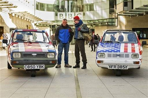 "In this image made available on Tuesday May 24, 2016 by the BBC America,  TV presenter and disc jockey Chris Evans, right, speaks with Top Gear co-presenter US actor and Matt LeBlanc as they prepare for there first challenge in London in this undated image. Top Gear� doesn't do understatement. If it were a car, the BBC's hit auto show would be a flashy, precision-tooled racer. Co-host Chris Evans calls it ""a car-show nuclear bomb�  and it returns to the screen facing the fallout of former host Jeremy Clarkson's explosive exit. (Mark Yeoman BBC America via AP)"