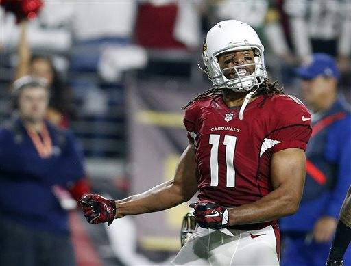 In this Saturday, Jan. 16, 2016 photo, Arizona Cardinals wide receiver Larry Fitzgerald (11) reacts during an NFL divisional playoff football game against the Green Bay Packers in Glendale, Ariz. Fitzgerald enters the final year of a two-year, $22 million contract, and he said Tuesday, May 24, that he doesn't even think about whether he will play football beyond this season, with the Cardinals or anyone else. (AP Photo/Rick Scuteri)