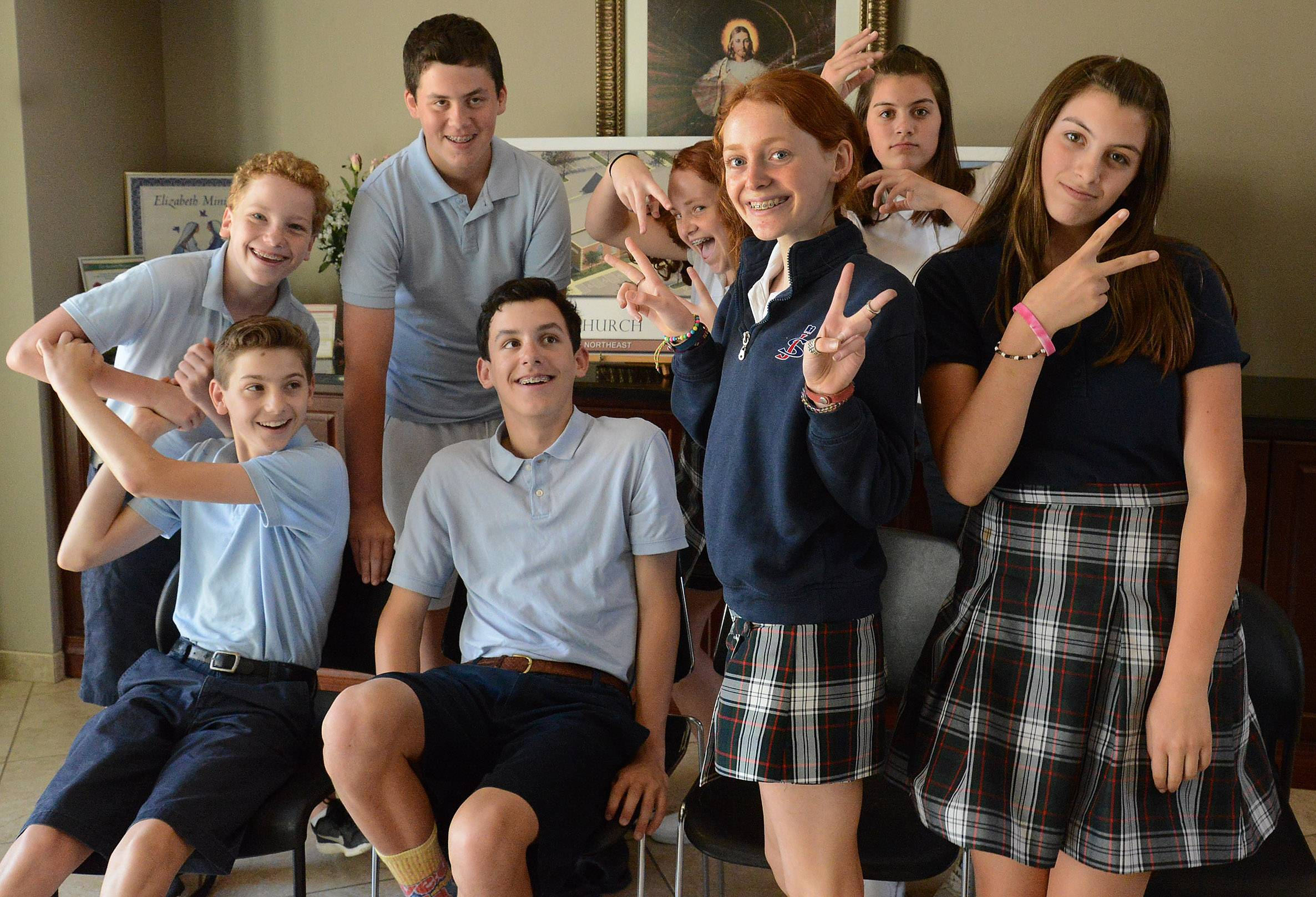Four sets of twins at St. James School in Arlington Heights are graduating from eighth grade: from left, Matthew (seated) and Lucas Lisowsky, Adam (seated) and Matthew Mysza, Erin (foreground) and Meghan Martin (behind), and Isabella (foreground) and Gabriella (back) Venturini.
