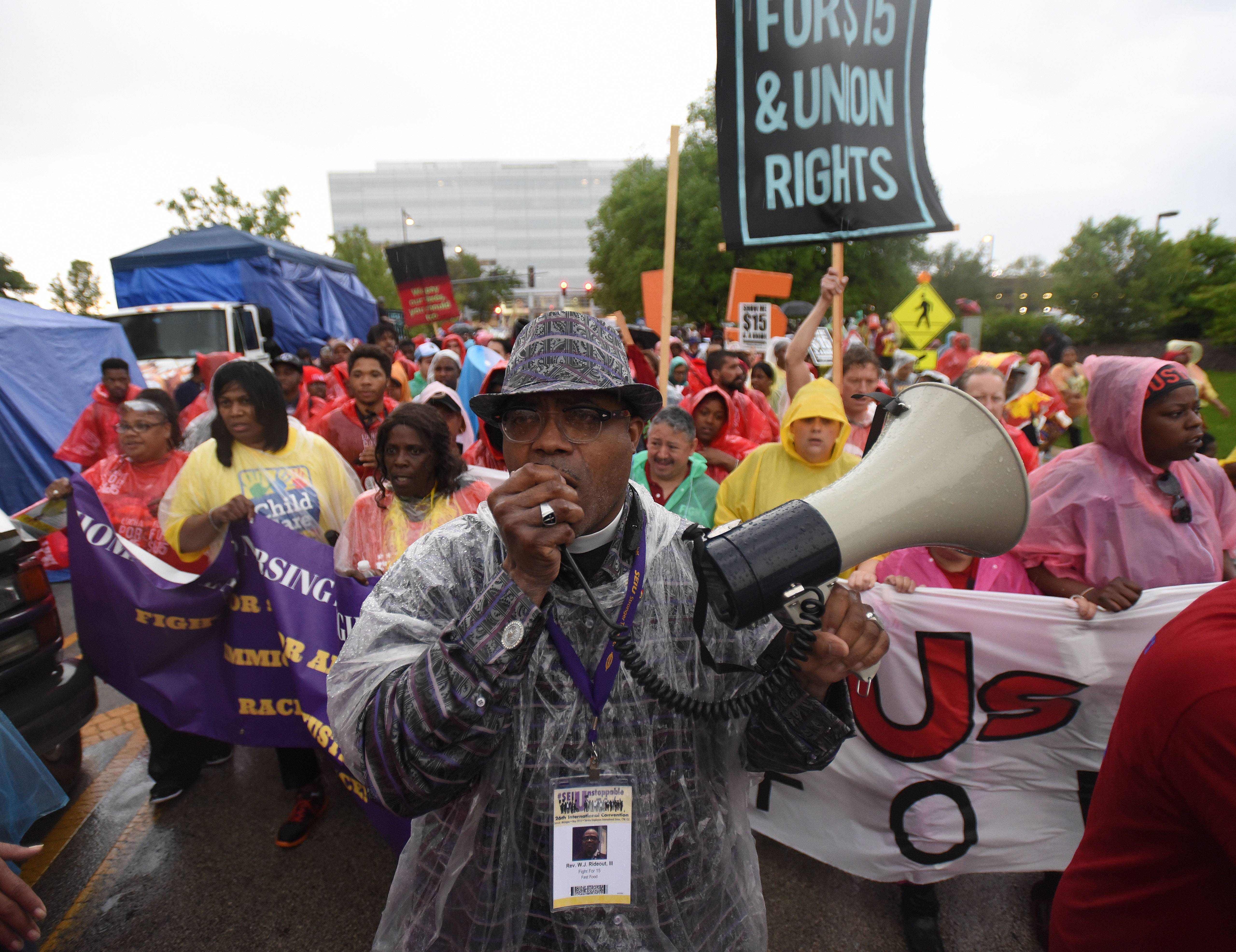 The Rev W.J. Rideout took charge of nearly 3,000 protesters during a super sized protest in the rain on Wednesday evening at McDonald's U.S. Headquarters in Oakbrook. Cooks and cashiers were protesting low wages in hopes of getting a pay increase to $15.00 an hour like in New York and California.