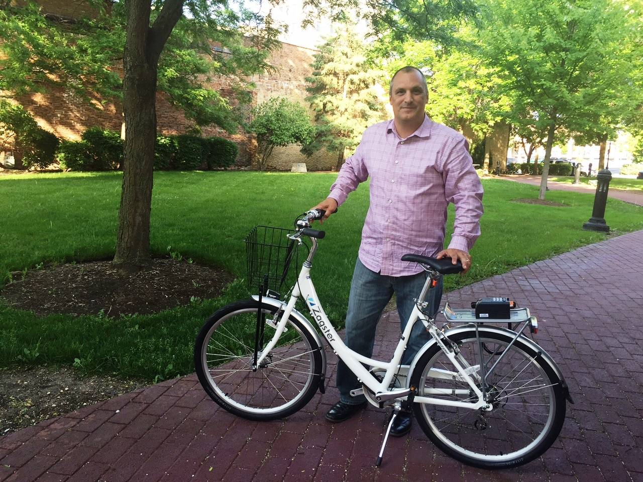 Eric Gallt, Aurora's traffic engineer, shows an example of the rental bikes that will be available next month at three downtown stations.