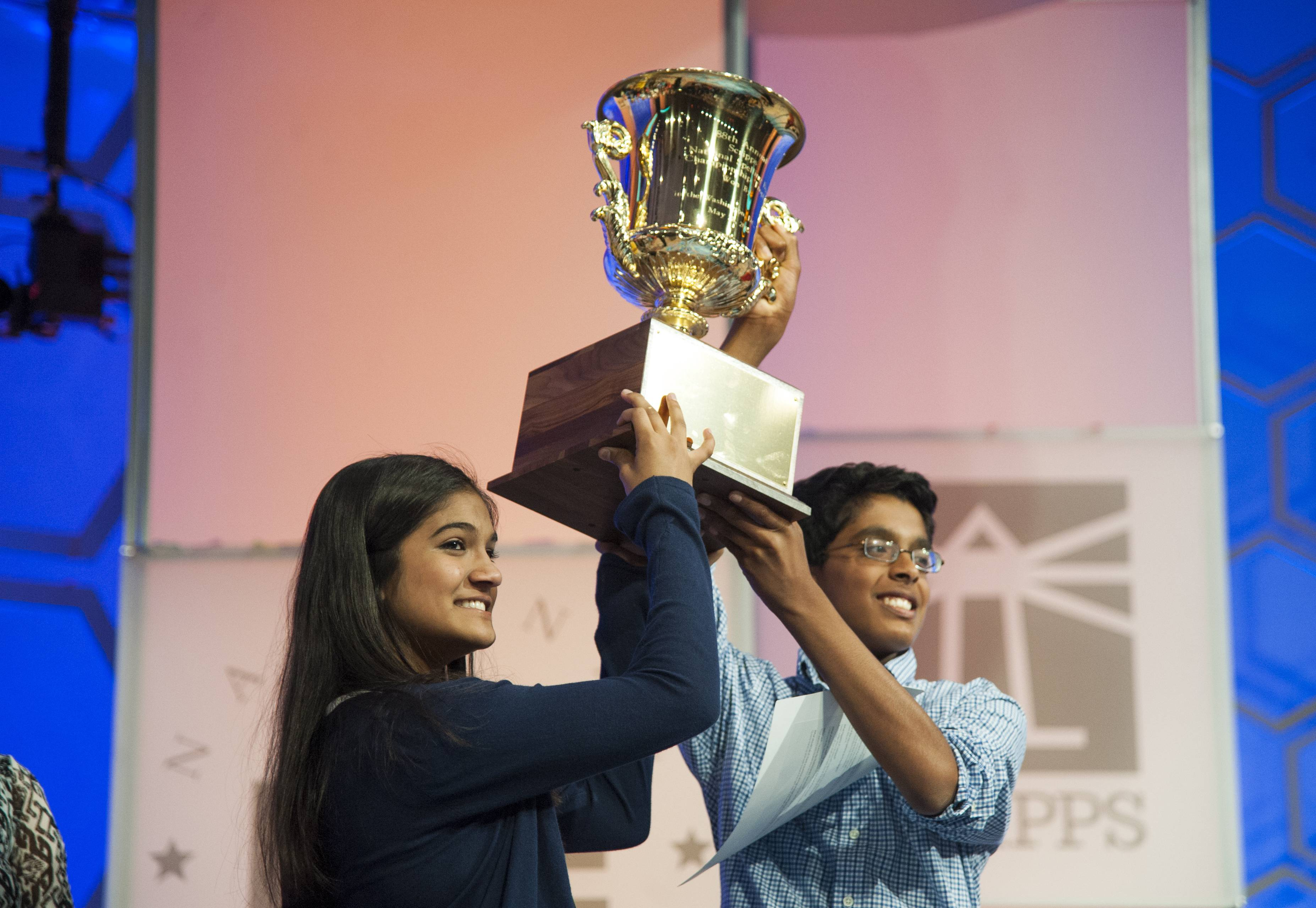 National Spelling Bee co-champions Vanya Shivashankar, 13, and Gokul Venkatachalam, 14, hoist the trophy together in 2015.