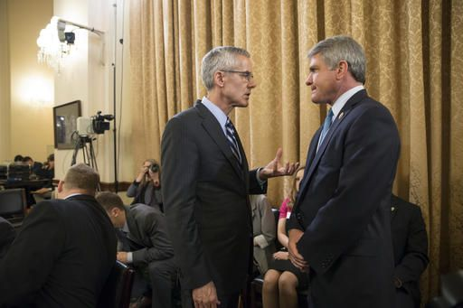 Transportation Security Administration (TSA) chief Peter Neffenger, left, confers with House Homeland Security Committee Chairman Rep. Michael McCaul, R-Texas, on Capitol Hill in Washington, Wednesday, May 25, 2016, prior to testifying before the committee's hearing on long lines at airport checkpoints.