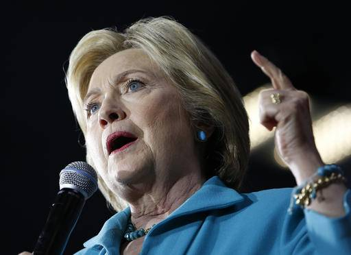 In this photo taken May 24,2016, Democratic presidential candidate Hillary Clinton speaks in Commerce, Calif. Hillary Clinton disregarded State Department cybersecurity guidelines by using a private email account and server, an internal audit found Wednesday, May 25, 2016. Her staff twice brushed aside specific concerns that she wasn't following federal rules. (AP Photo/John Locher)
