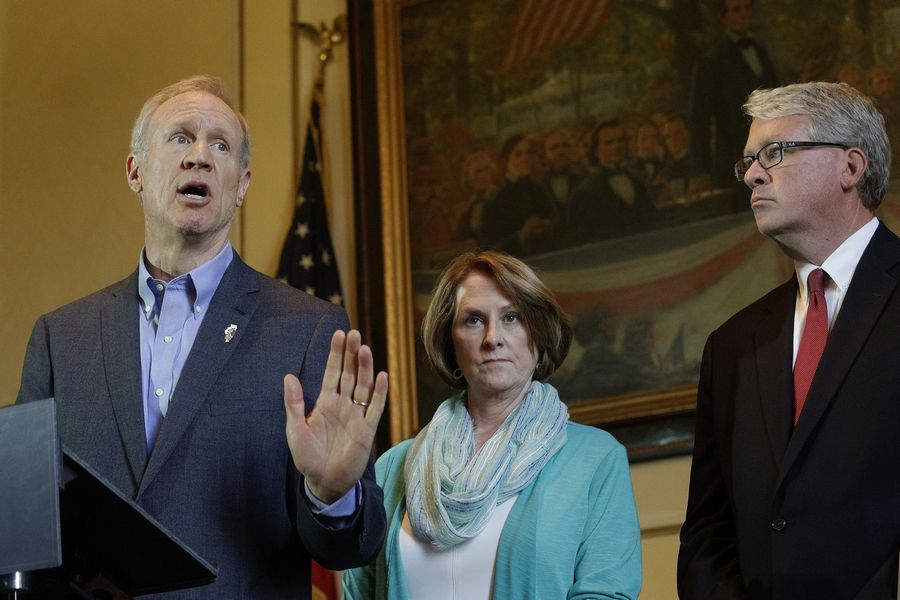 Gov. Bruce Rauner speaks to reporters in his office in Springfield, alongside Senate Minority Leader Christine Radogno, a Lemont Republican, center, and House Minority Leader Jim Durkin, a Western Springs Republican.