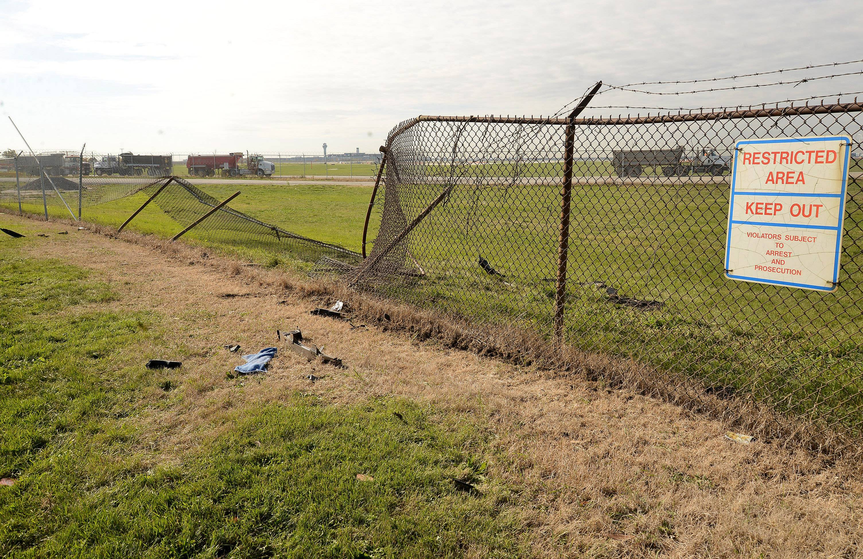 Security fencing around O'Hare International Airport took a beating when a motorist crashed into it in fall of 2013. There have been 10 cases of people breaching fences and gates since 2004.