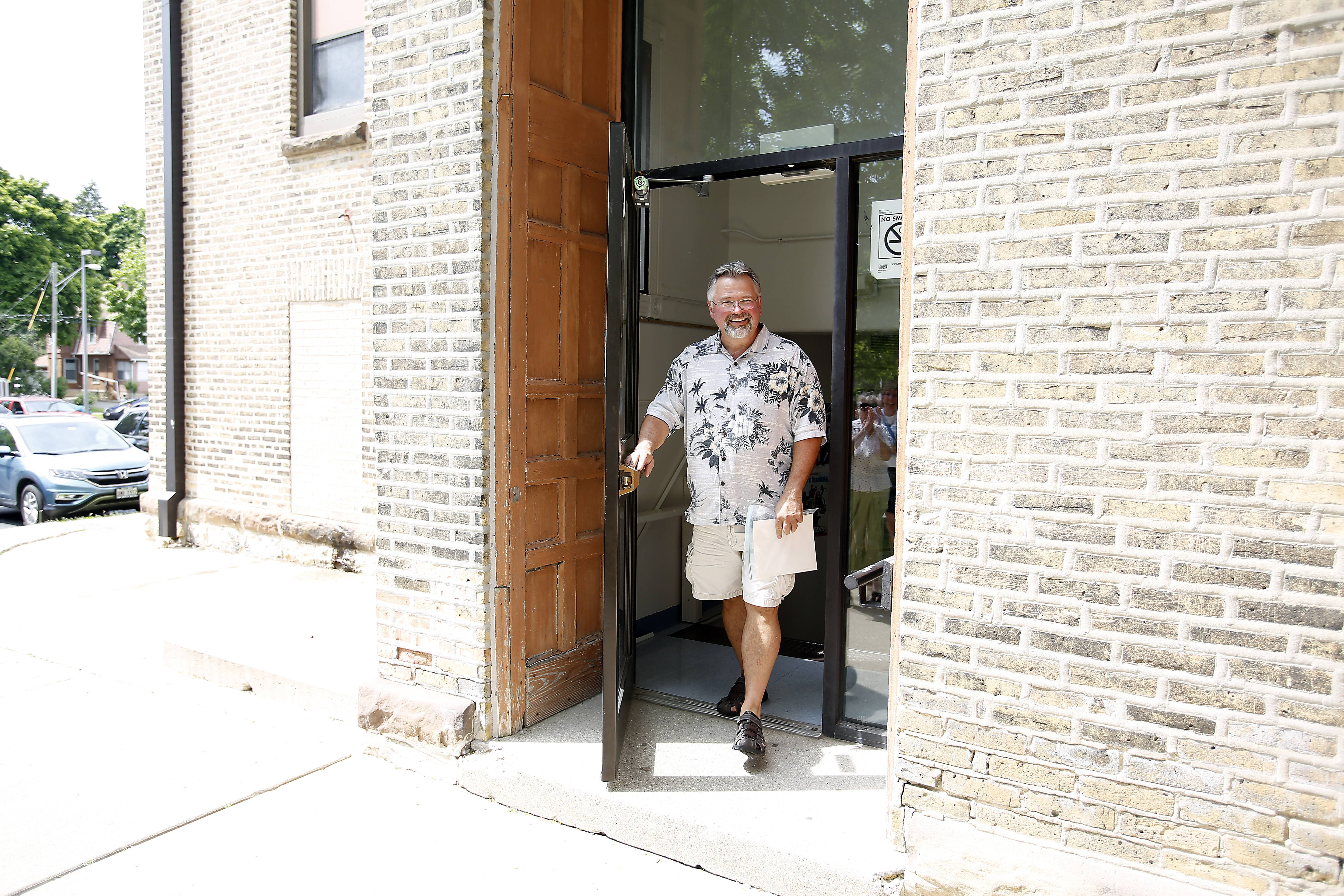 Gordon Whiting, Elgin High School social studies teacher, exits the district through the same door he first entered as a kindergartner at Garfield Elementary School in Elgin.