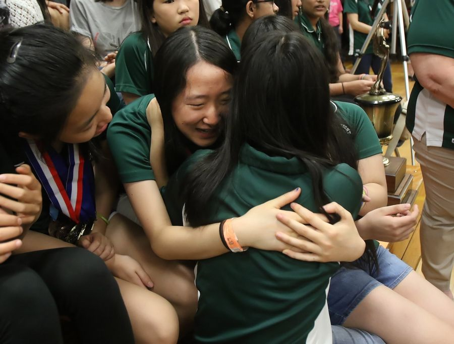 Wright Junior High School Science Olympiad team members Emily Liu hugs Emily Lu before the start Wednesday's assembly at the Lincolnshire school to honor the team's national championship. Mayor Elizabeth Brandt presented a proclamation in recognition of the team and its accomplishments.