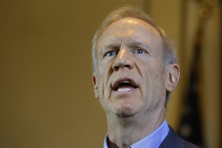 Illinois Gov. Bruce Rauner's veto of a plan that could have prevented a strike by the American Federation of State, County and Municipal Employees and sent talks to an binding arbitration withstood an override challenge.