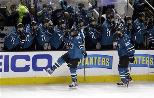 The San Jose Sharks' Joel Ward (42) celebrates with teammates after scoring against the St. Louis Blues during the third period in Game 6 of the NHL hockey Stanley Cup Western Conference finals Wednesday, May 25, 2016, in San Jose, Calif. (AP Photo/Marcio Jose Sanchez)