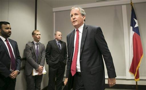 Republican Texas Attorney General Ken Paxton walks away after announcing Texas' lawsuit to challenge President Obama's transgender bathroom order during a news conference in Austin, Texas, Wednesday May 25, 2016. Texas and several other states are suing the Obama administration over its directive to U.S. public schools to let transgender students use the bathrooms and locker rooms that match their gender identity. (Jay Janner/Austin American-Statesman via AP) AUSTIN CHRONICLE OUT, COMMUNITY IMPACT OUT, INTERNET AND TV MUST CREDIT PHOTOGRAPHER AND STATESMAN.COM, MAGS OUT; MANDATORY CREDIT