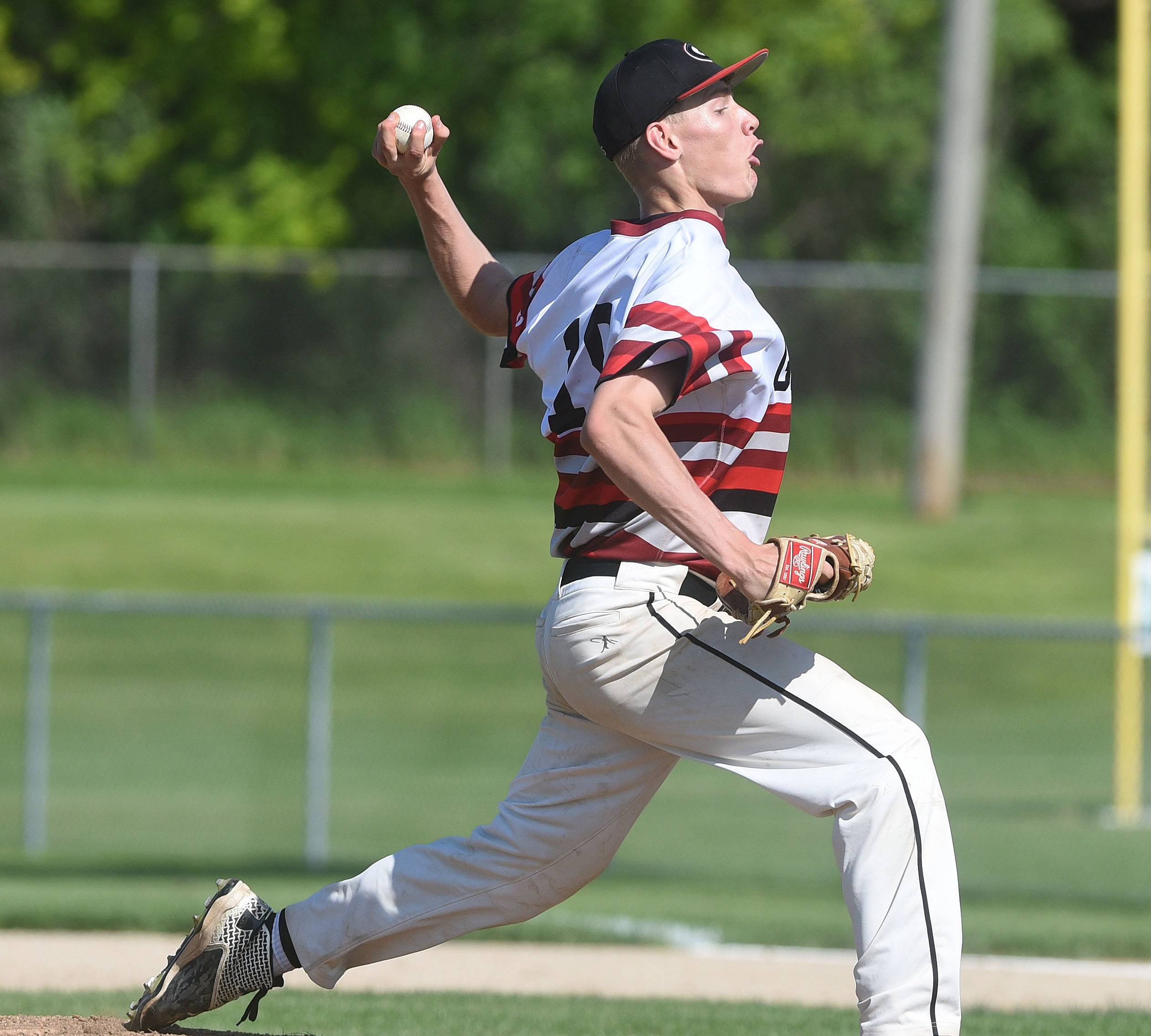 The Glenbard East pitcher Michael Sebby lets a pitch fly on the mound. This took place during the Glenbard East vs. Glenbard West Class 4A Glenbard West baseball regional semifinals Thursday.