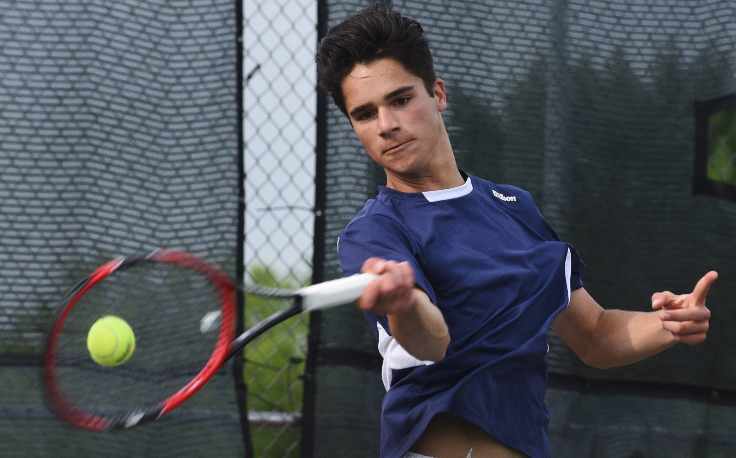 Burlington Central's Nicholas Welker plays during the boys state tennis preliminaries at Rolling Meadows High School Thursday.