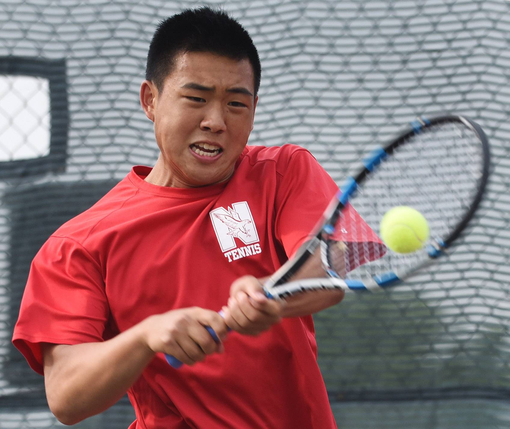 Naperville Central's Bill Zhang competes during the boys state tennis preliminaries at Rolling Meadows High School Thursday.