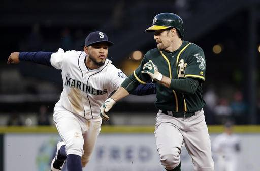Seattle Mariners shortstop Luis Sardinas, left, lunges to tag out Oakland Athletics' Billy Burns on a rundown between first and second bases in the fifth inning of a baseball game Wednesday, May 25, 2016, in Seattle. (AP Photo/Elaine Thompson)