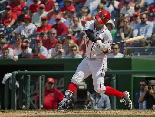 Washington Nationals Bryce Harper swings to ground out in the eight inning, as a pinch hitter in a baseball game against the New York Mets, Wednesday, May 25, 2016, in Washington. New York won 2-0. (AP Photo/Pablo Martinez Monsivais)
