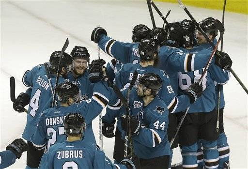 San Jose Sharks players celebrate after beating the St. Louis Blues in Game 6 of the NHL hockey Stanley Cup Western Conference finals in San Jose, Calif., Wednesday, May 25, 2016. The Sharks won 5-2. (AP Photo/Jeff Chiu)