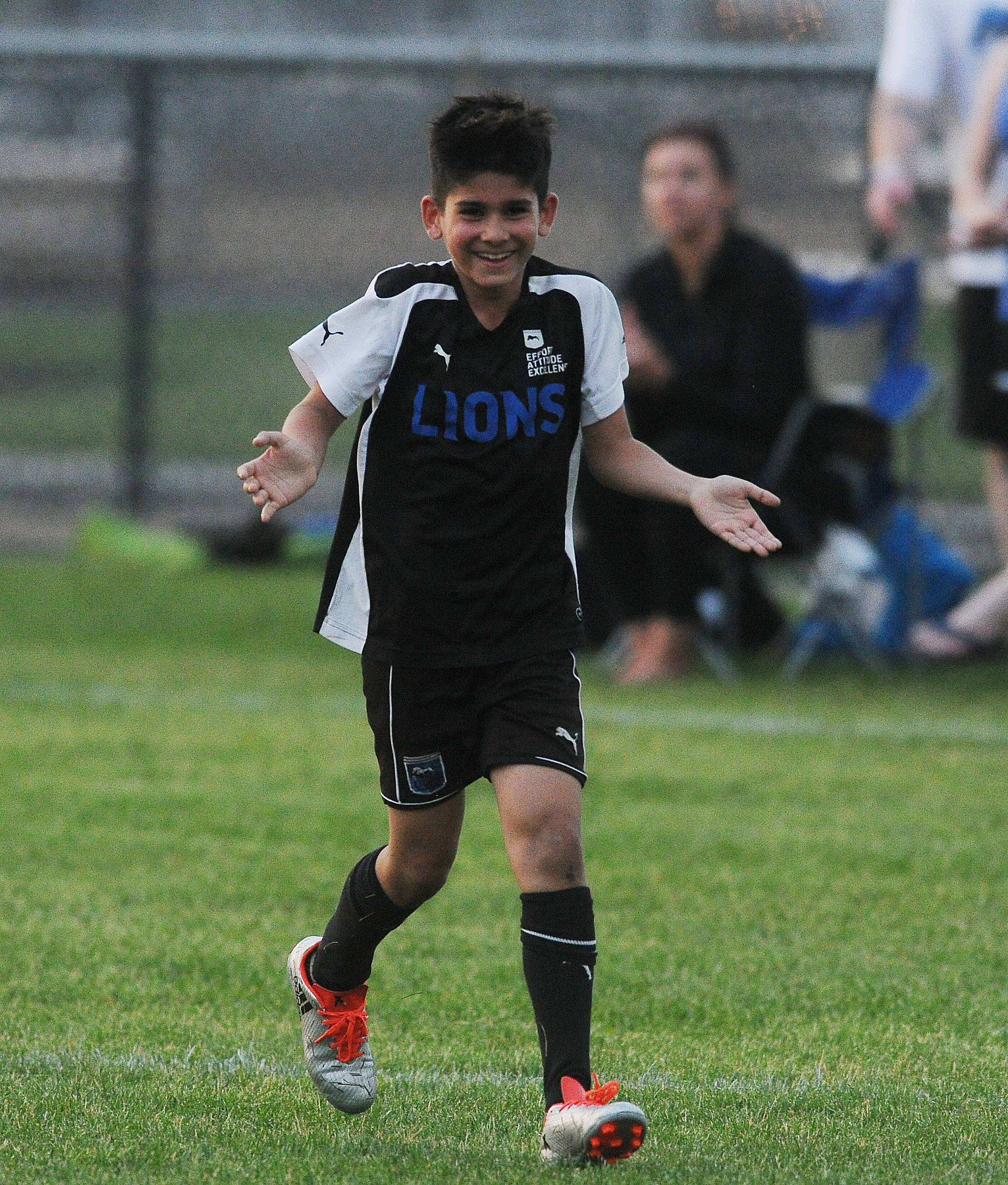 Lions SC U10 player Zach Abraham, defender, reacts after scoring a goal against the Chicago CSA Barcelona at the Grove United Memorial Day Shootout soccer tournament Friday in Schaumburg.