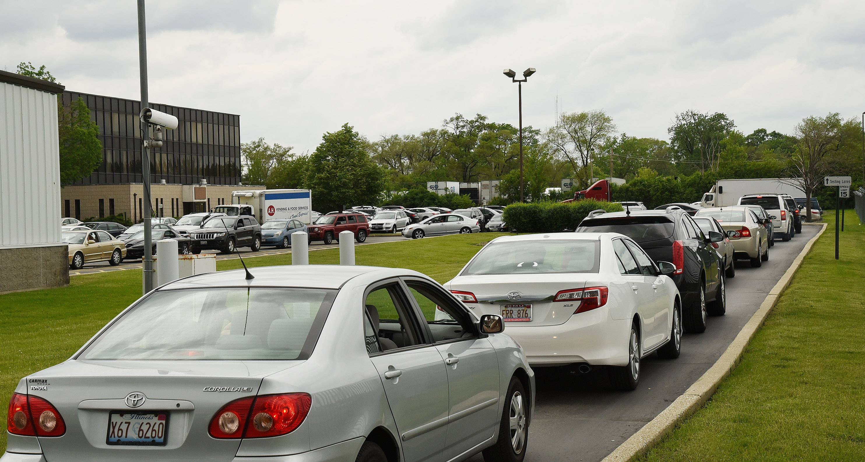 Emission test requirement, holiday weekend spur long lines