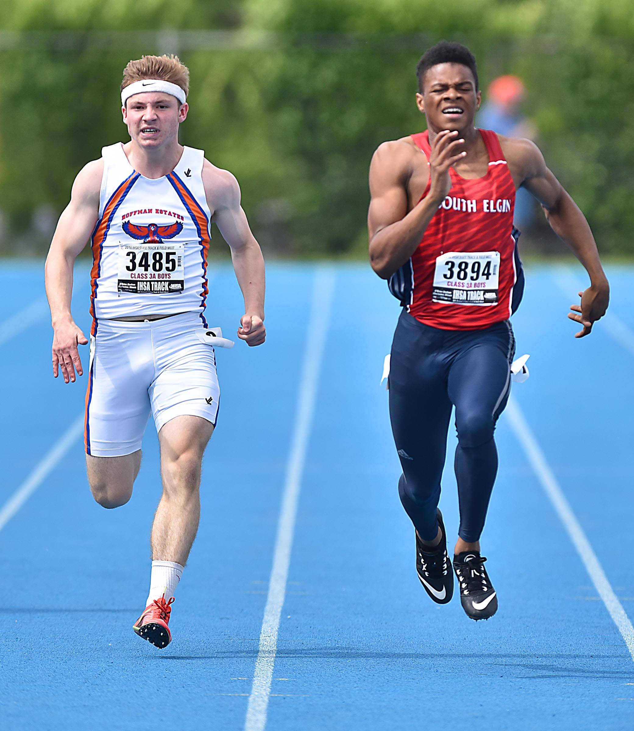 South Elgin's Jaurice Thomas and Hoffman Estates' Declan Rustay battle to the finish in the 200 meter dash Friday at the boys track state finals prelim events in O'Brien Stadium at Eastern Illinois University in Charleston. Thomas won and Rustay finished less than a quarter of a second behind.
