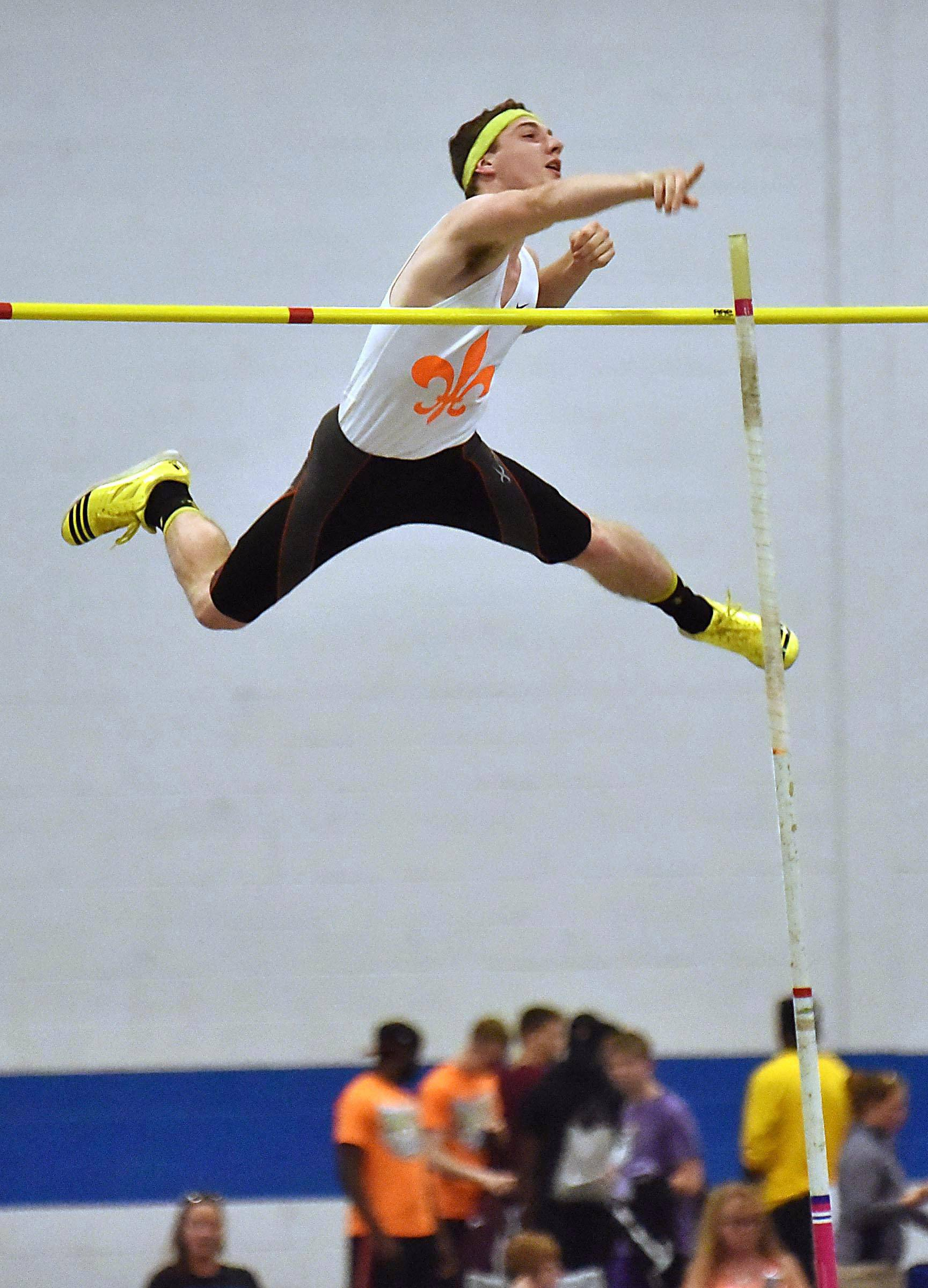 St. Charles East's Colton Weber clears the 13 foot 6 inch bar in the pole vault Friday at the boys track state finals prelim events at Eastern Illinois University in Charleston.