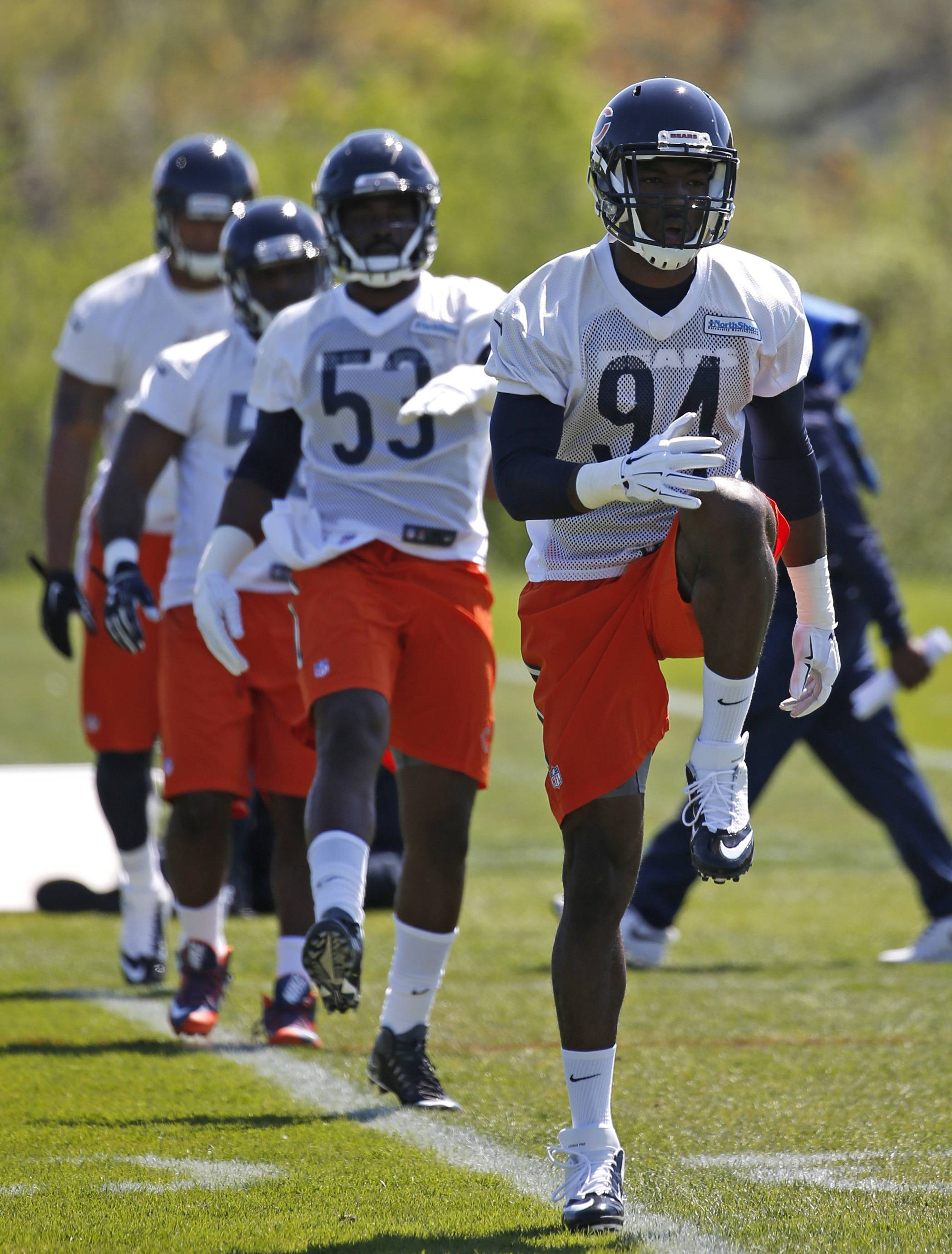 Chicago Bears rookie linebacker Leonard Floyd (94) warms up with teammates during the team's NFL rookie camp football practice at Halas Hall Friday, May 13, 2016, in Lake Forest, Ill.