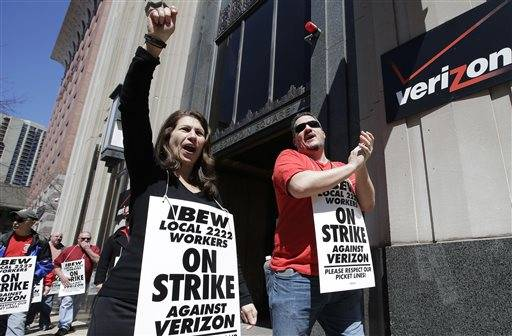 FILE - In this April 13, 2016 file photo, Verizon workers picket outside one of the company's facilities in Boston. Striking Verizon employees may be back to work next week after the company and its unions reached an agreement in principle, Friday, May 17, for a four-year contract. About 39,000 Verizon Communications Inc. landline and cable employees in nine eastern states and Washington, D.C., have been on strike since April. They had been working without a contract since last August. (AP Photo/Steven Senne)
