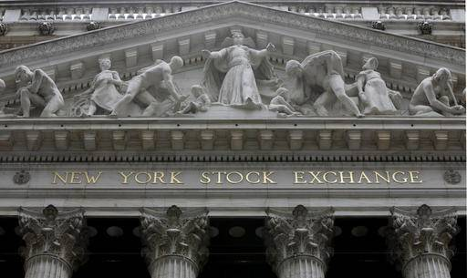 FILE - This Oct. 4, 2014, file photo, shows the facade of the New York Stock Exchange. Stock markets around the world edged higher Thursday, May 26, 2016, as traders interpreted the rise in oil prices to $50 a barrel for the first time this year as a positive sign for the global economy. (AP Photo/Richard Drew, File)