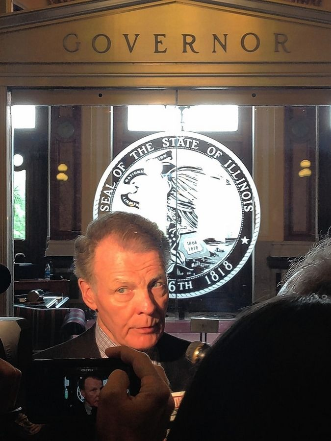 Democratic House Speaker Michael Madigan takes questions in front of Gov. Bruce Rauner's office.