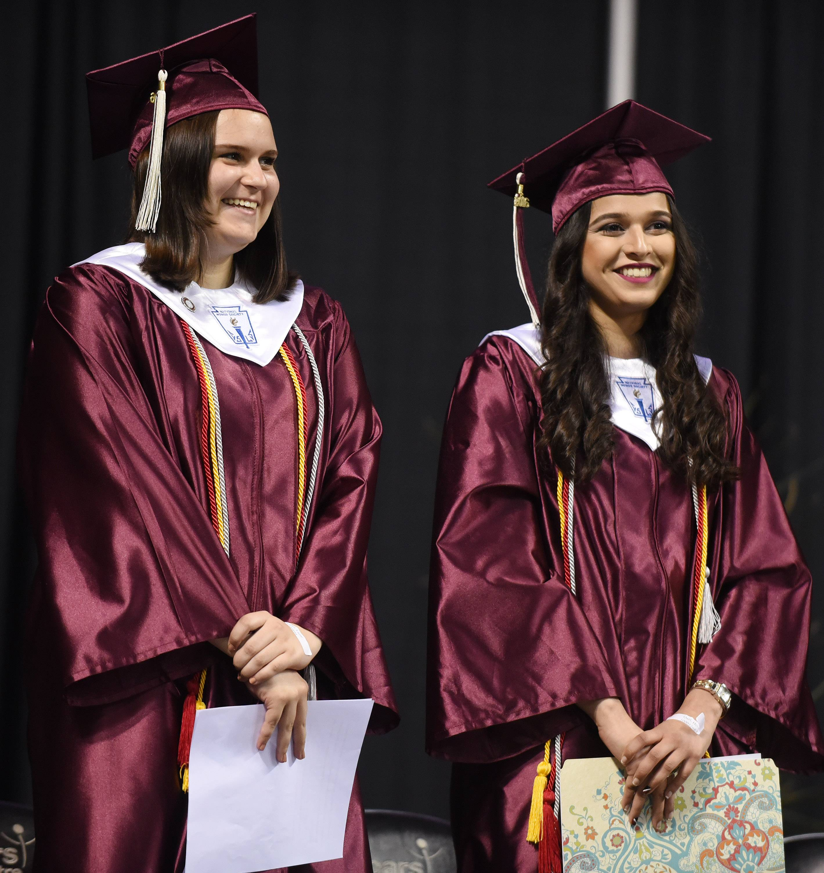 Two of the four valedictorians, Laine Kaehler, left, and Heba Qazi, are introduced on stage prior to speaking during Elgin High School's graduation ceremony at the Sears Centre in Hoffman Estates Saturday. Taha Ahmad and Courtney Marie Ban are also valedictorians for the class of 2016.