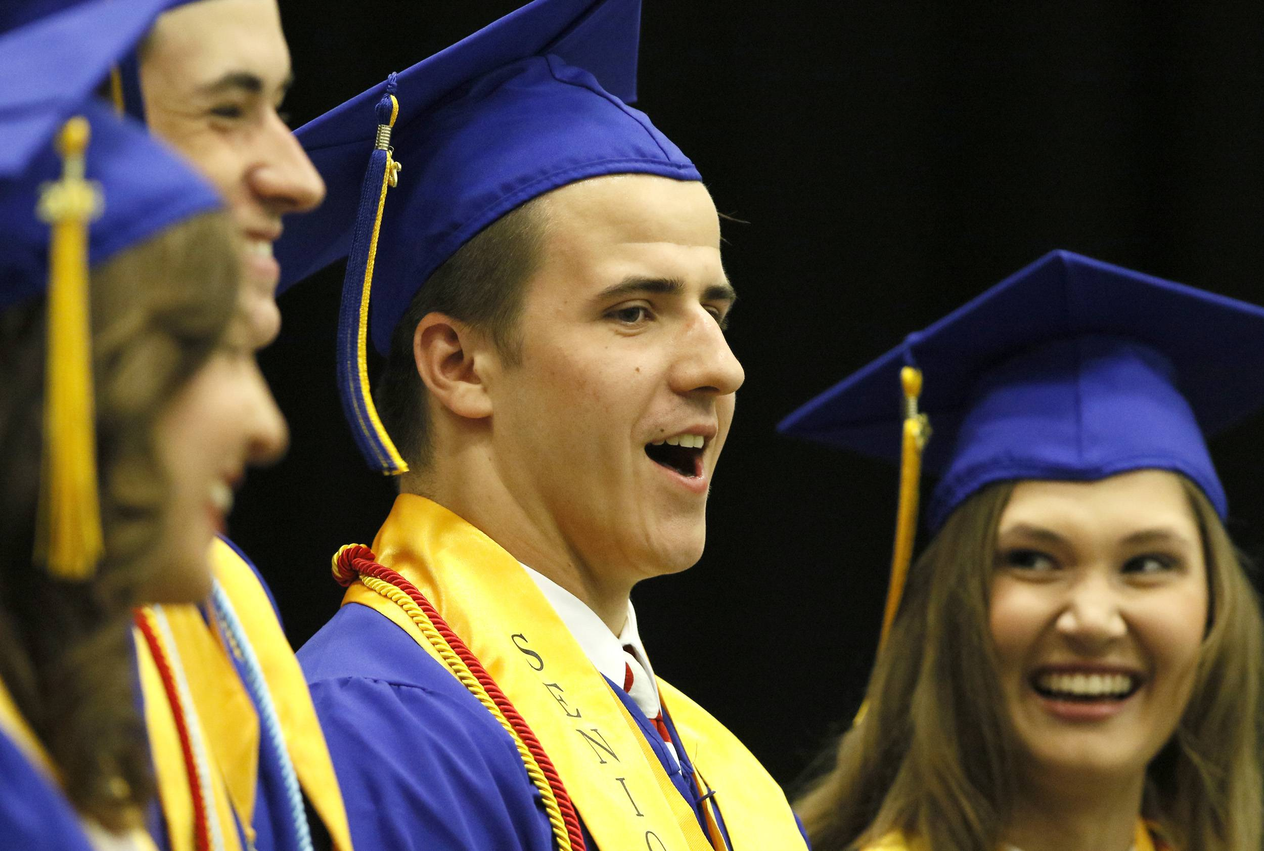 Class President Crayton Shepherd stands on the graduation stage during the Wheaton North graduation.