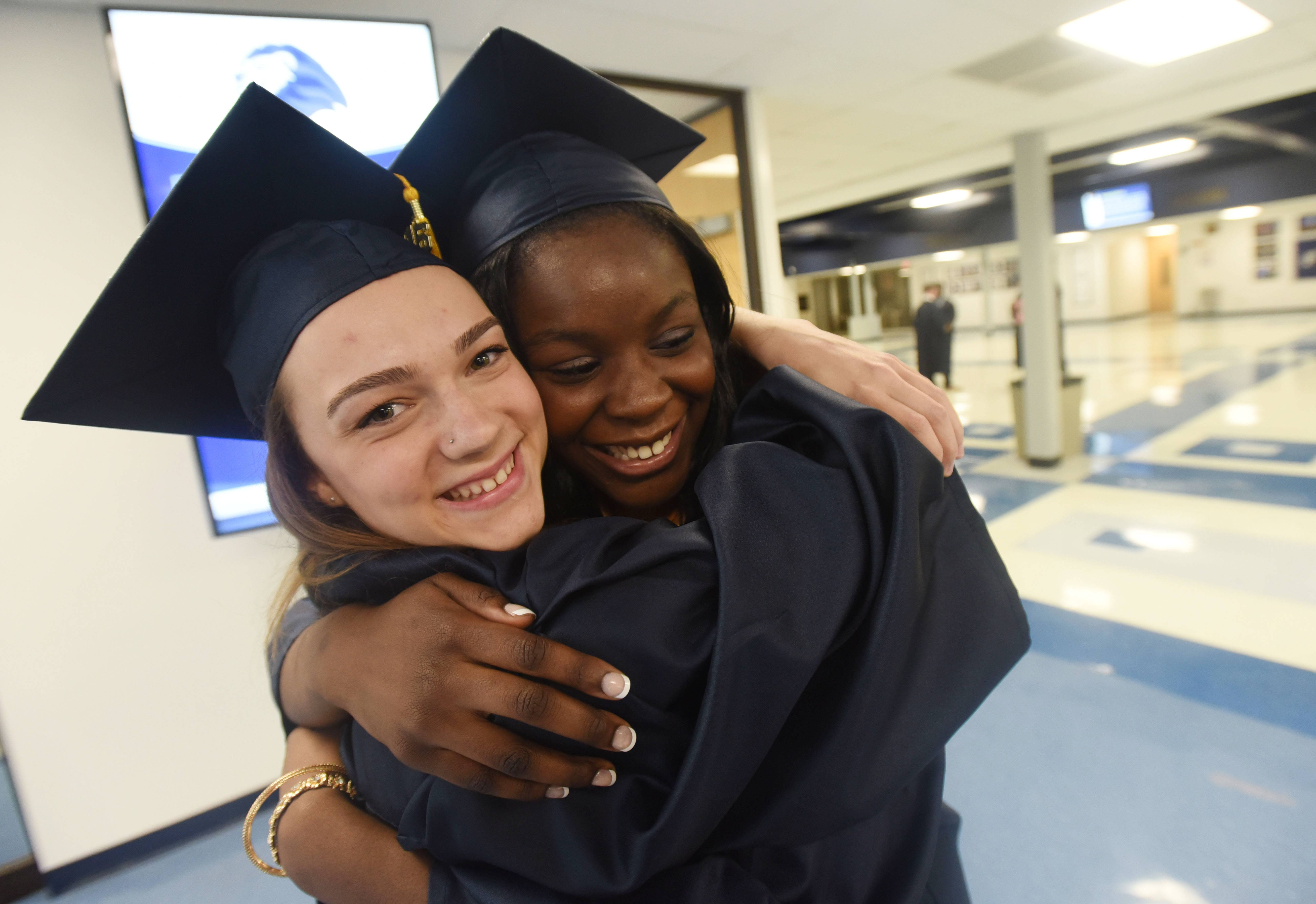 Victoria Pankow, 17, and Cindy Osagie, 17, embrace.