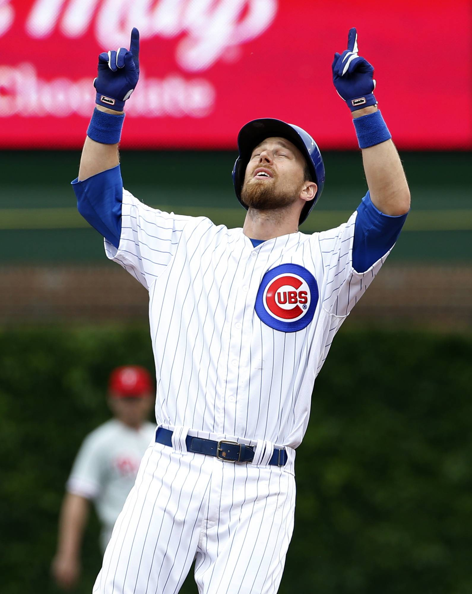 Chicago Cubs' Ben Zobrist celebrates after hitting an an RBI double during the first inning of a baseball game against the Philadelphia Phillies Saturday, May 28, 2016, in Chicago. (AP Photo/Nam Y. Huh)