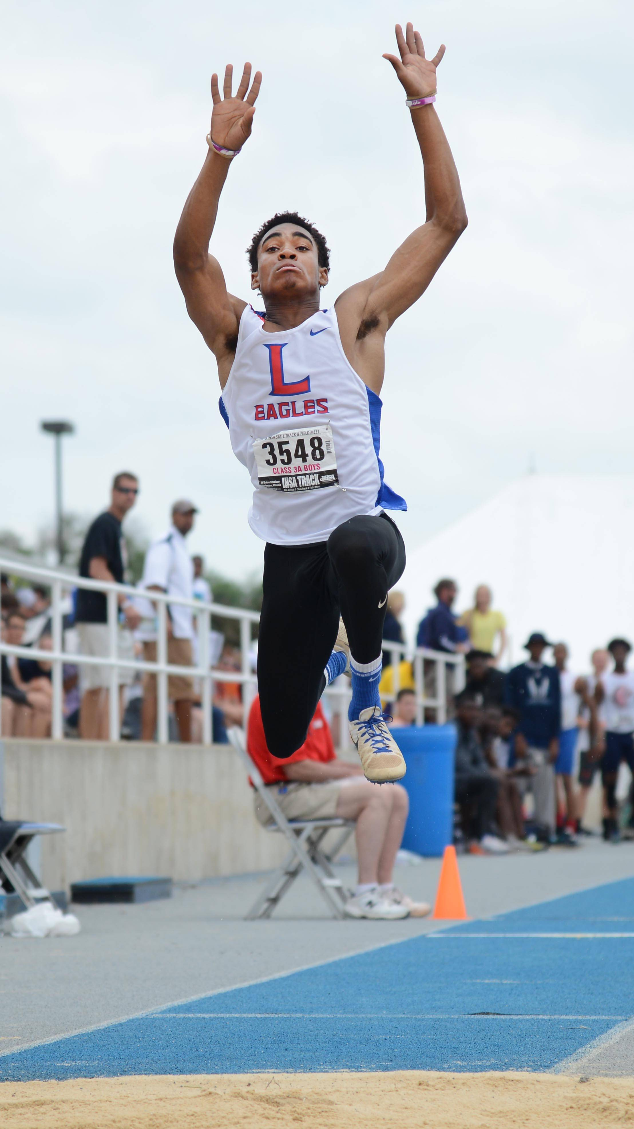 Lakes' Cameron Ruiz bounds toward a title in the triple jump Saturday during the boys track and field state finals at Eastern Illinois' O'Brien Stadium.